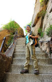 Woman climbing thousands steps at mount hua Royalty Free Stock Photos