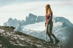 Woman climbing to mountain summit. Travel healthy lifestyle concept active weekend summer vacations in Norway Royalty Free Stock Photography