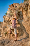 Woman climbing to the top of the mountain Royalty Free Stock Photography