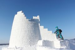 Woman climbing up the steps of a snow tower, Novosibirsk, Russia. Woman climbing up the steps of snow tower, Novosibirsk, Russia stock image