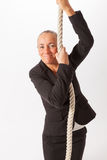 The woman is climbing up a thick rope Stock Photos