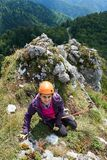 Climbing on via ferrata. Woman climbing on a via ferrata route in the mountains Royalty Free Stock Photography