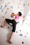 Woman at the climbing wall Royalty Free Stock Photo