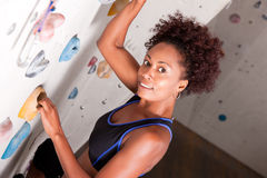 Woman at the climbing wall Royalty Free Stock Images