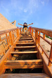 Woman climbing  wooden steps at mount hua Royalty Free Stock Image
