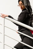 Woman climbs the stairs Stock Photos