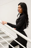 Woman climbs the stairs Royalty Free Stock Image