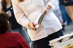 Woman with clipboard Stock Image