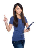 Woman with clipboard with finger up Royalty Free Stock Images