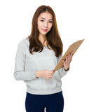Woman with clipboard Stock Photography