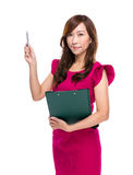 Woman with clipboard and pen point up Royalty Free Stock Image