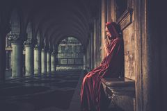 Woman in cloak praying Royalty Free Stock Photo