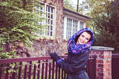 Woman in cloak and scarf on the head looking at camera Royalty Free Stock Images
