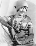 Woman in a cloche hat and satin dress looking vivacious Royalty Free Stock Image