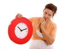 Woman and clock Stock Photos