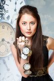 Woman with clock Royalty Free Stock Photos