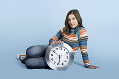 Woman with a clock Stock Image
