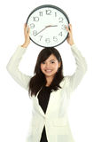 Woman with clock Stock Images