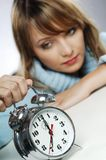 Woman with clock royalty free stock photography