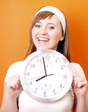 Woman and clock Stock Photos