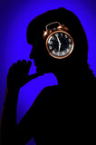 Woman and clock Stock Image
