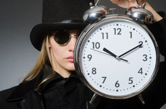 The woman with clock in business concept Stock Photo