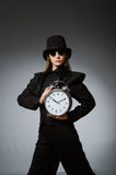 The woman with clock in business concept Royalty Free Stock Photos