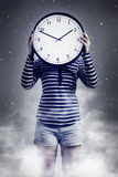 Woman with clock dreaming Stock Images