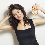 Woman with clock in hands Royalty Free Stock Photography