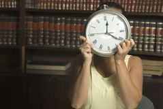 Woman with Clock - Horizontal Stock Images