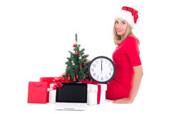Woman with clock,notebook,  christmas tree and gifts  on Royalty Free Stock Images