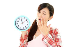 Woman with a clock Stock Photos