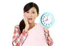 Woman with a clock Royalty Free Stock Photos