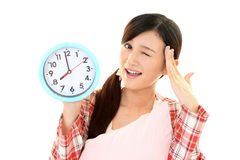 Woman with a clock Stock Images