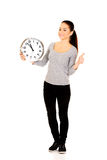 Woman with a clock and thumbs up. Stock Photography