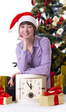 Woman with clock under Christmas tree royalty free stock images