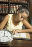 Woman with Clock - Vertical Stock Image