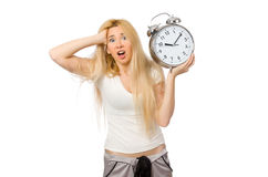 Woman with clock on white Stock Photography