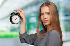 Woman with clock. Young business woman with clock Royalty Free Stock Photo