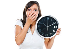 Woman with clock Stock Image
