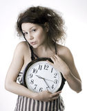 Woman & clocks Stock Image