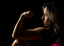 Woman close with biceps highlighted and flexed Stock Photo