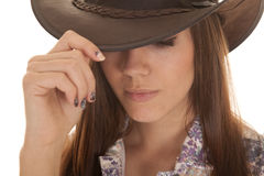Woman close in hat hold look down Stock Photos