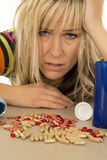 Woman close over dosing on pills Royalty Free Stock Photo
