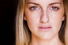 Woman close portrait. Young blond woman close portrait Stock Images