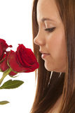 Woman close side smell rose Stock Image