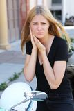 Woman with earache outside royalty free stock photo