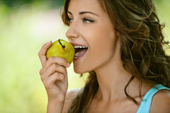 Woman close-up in blue shirt pear Stock Photo