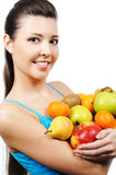 Woman close-up with fruits Royalty Free Stock Photos