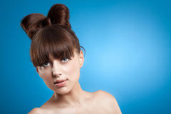 Woman close-up portrait. Beautiful young woman close-up portrait over blue background Royalty Free Stock Images